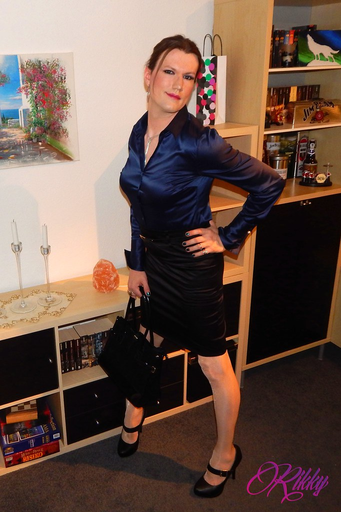 Transvestite in tight skirt