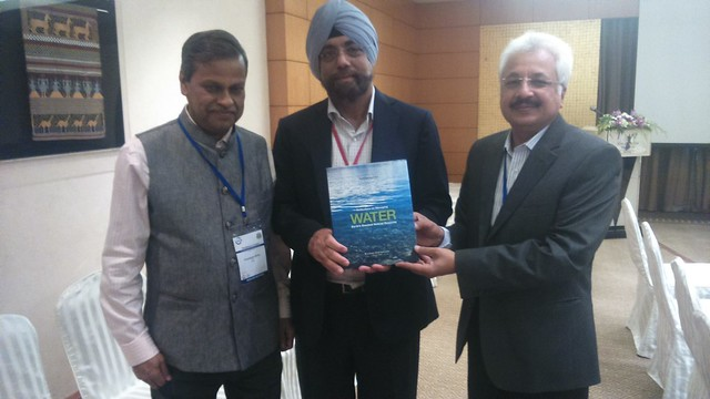 Water Book being presented to Dr. T.P. Singh, IUCN Asia Deputy Regional Director & P.R. Sinha, IUCN India Head at Bangkok Thailand.JPG