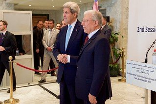 Secretary Kerry Shakes Hands with Foreign Minister Baccouche Before a News Conference at the Ministry of Foreign Affairs in Tunis