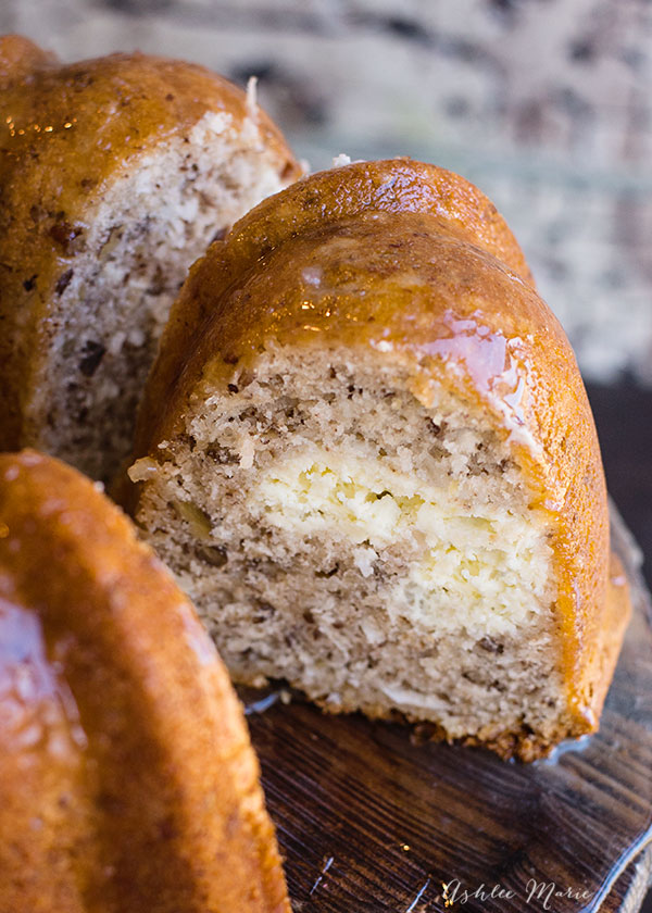 a ribbon of cheesecake is a wonderful surprise in this bundt cake, add the coconut glaze and you will fall in love