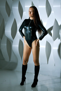 Marusya Klimova in black catsuit and black high heels boots