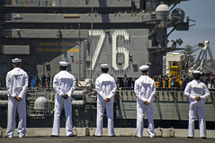 Sailors man the rails on the flight deck of USS George Washington (CVN 73) as the aircraft carrier arrives in San Diego to conduct a hull-swap with USS Ronald Reagan (CVN 76).  (U.S. Navy/MC3 Bryan Mai)