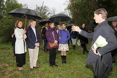 Liz and Patrick Garrett, Susan Doud and Dede Montgomery listen to Thomas Woltz on garden tour
