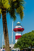 A clear blue sky features the Harbour Town Lighthouse - famous landmark in Hilton Head, SC, USA