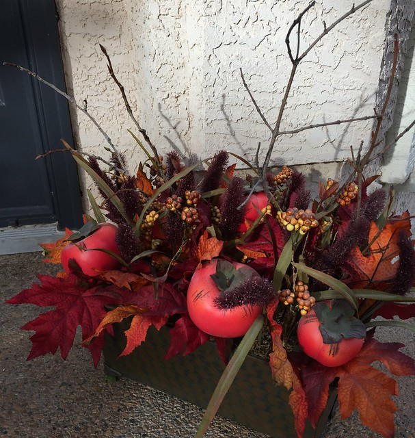 Outdoor Autumn arrangement with twigs added from nature