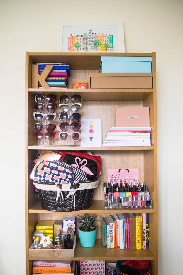 organised clutter on bookcase