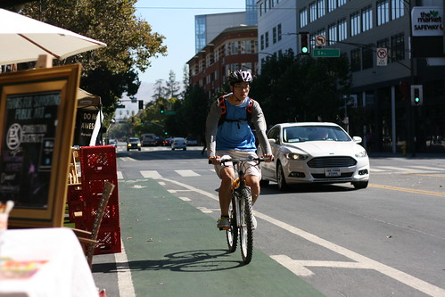 Cyclists in the green bike lane