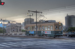 An old tramcar with A-Bomb Dome at Hiroshima in early morning on OCT 28, 2015 (1)