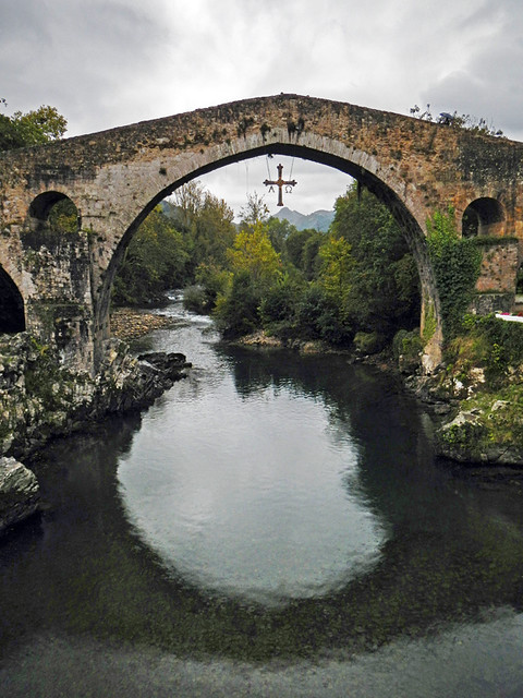 The Roman bridge and cross at Canga de Onis in Northern Spain
