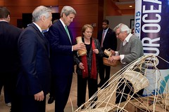 U.S. Secretary of State John Kerry, Chilean President Michelle Bachelet, and Chilean Foreign Minister Heraldo Muñoz look at a present for him made out of reeds at the 2015 Our Ocean conference in Valparaiso, Chile, on October 5, 2015. [State Department photo/ Public Domain]