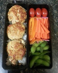 Bento box for November 6th: Tuna Tofu Miso mini burgers, rice, cherry tomatoes, carrots, orange peppers, edamame