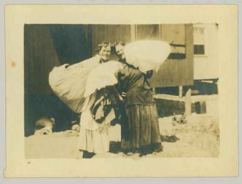 Two women doing something