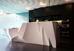 The kitchen island bench made of Corian