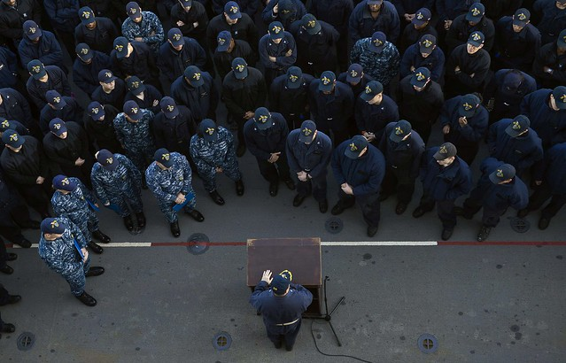 Capt. speaks to the crew during an all-hands call on the flight deck of USS Iwo Jima.