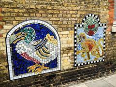 window(0.0), urban area(0.0), graffiti(0.0), modern art(0.0), art(1.0), mosaic(1.0), wall(1.0), street art(1.0), mural(1.0),