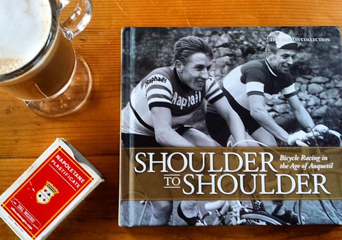 Coffee table book should be posed with coffee, don't you think?  Shoulder To Shoulder picture book covers European road cycling during the 1960s, when Jacques Anquetil brought panache to a sport traditionally defined as sufferfests defined by old guard ha