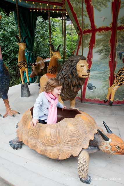Aggie inside a turtle on the carousel Dodo de Manege