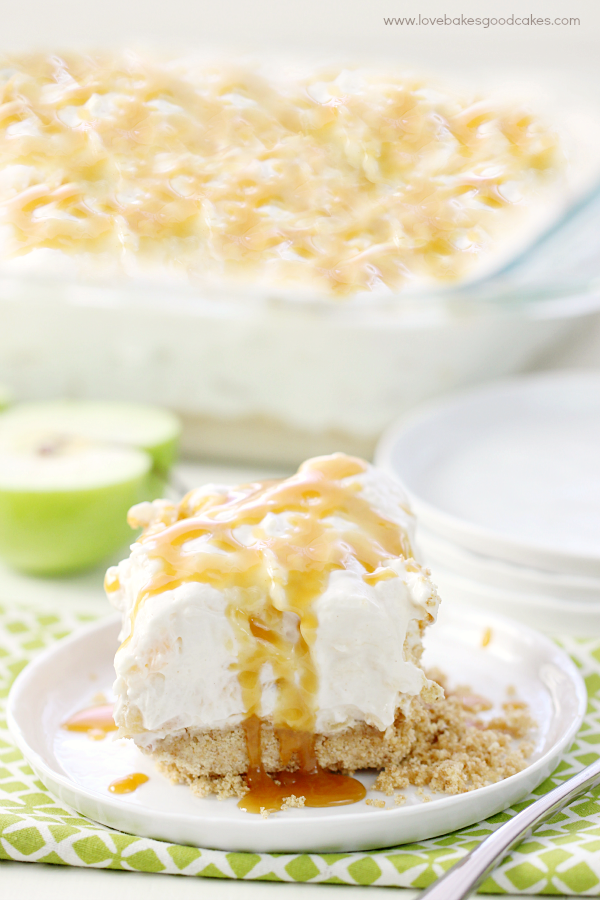 No-Bake Caramel Apple Cheesecake on a white plate with a fork.