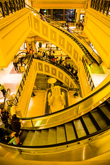 Spiraling escalators