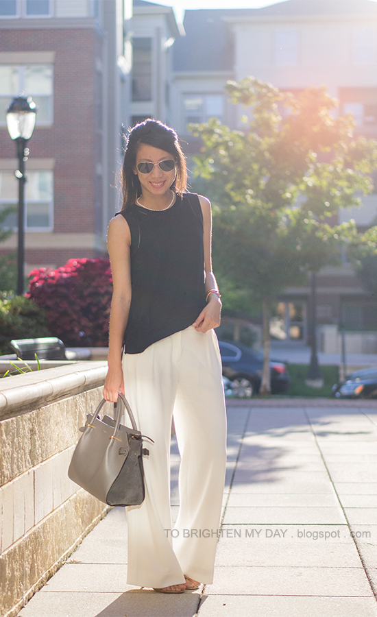 pearl necklace, black silk top, rose gold jewelry, white trousers, bow sandals