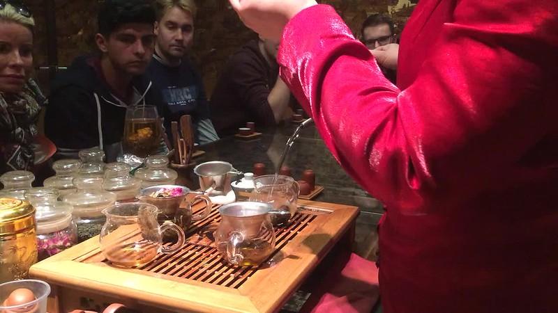 Staff explaining pu-erh tea.