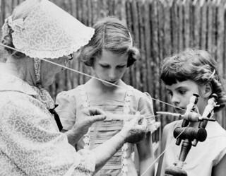 Jessie Coker demonstrating spinning at the 1959 Florida Folk Festival - White Springs