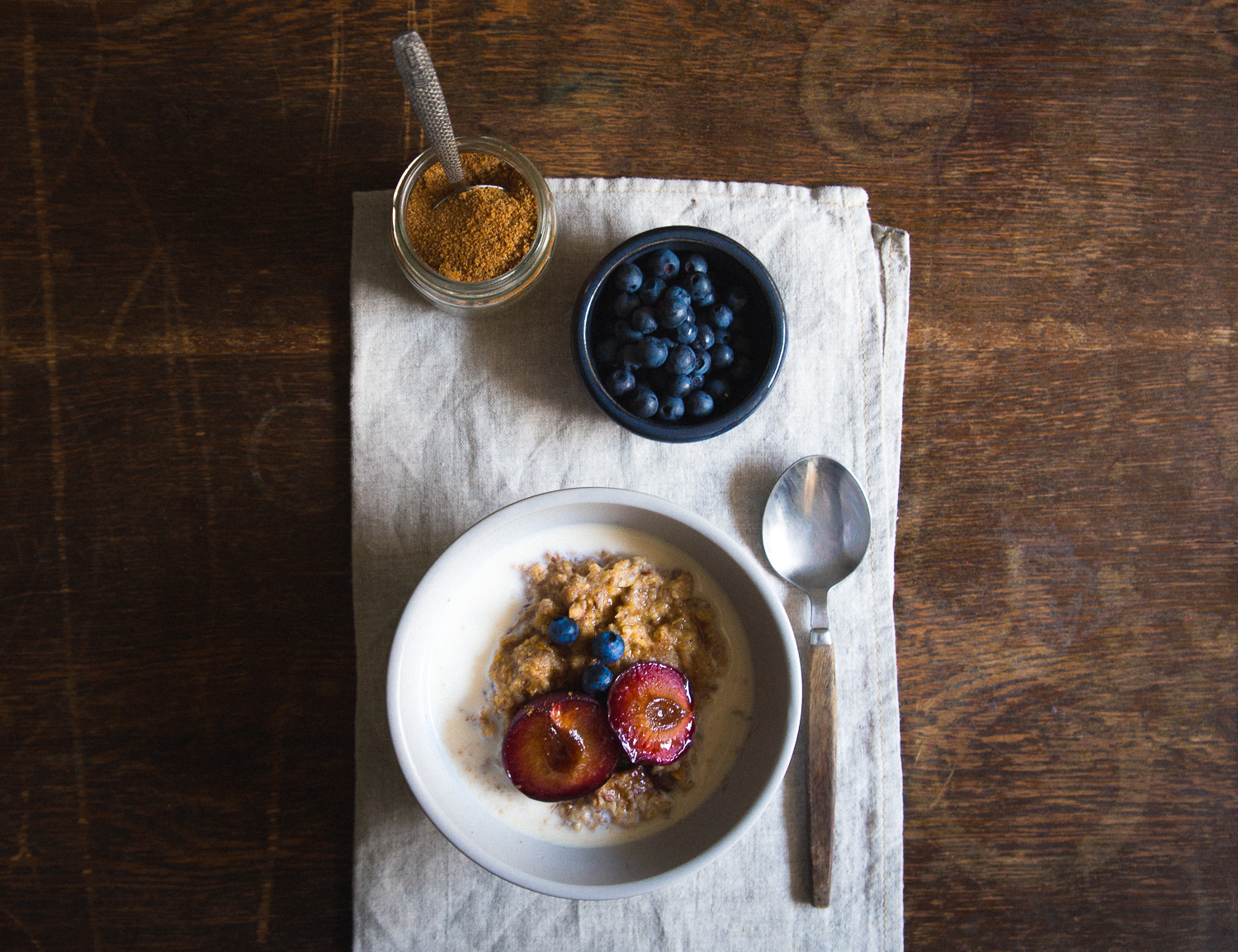 Multigrain Porridge with Balsamic Caramellized Plums & Goat Milk | Cashew Kitchen