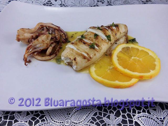 03-cannolo di calamaro ripieno di ricotta e arancia con salsa all'arancia
