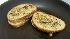 Grilled cheese made with dilled garlic butter.