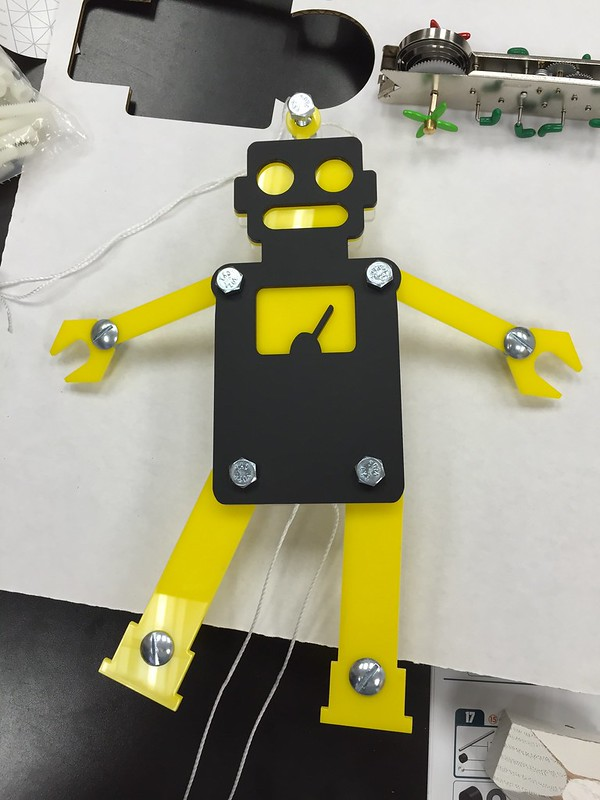 Laser cut acrylic robot pull string puppet
