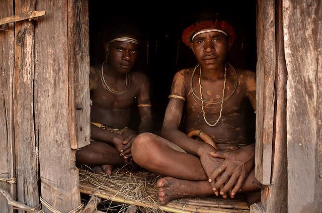 Dani boys in their hut, Papua, Indonesia