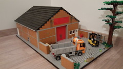 New warehouse building. Just need to give it a sign with the business name on the red wall section. Any suggestions?