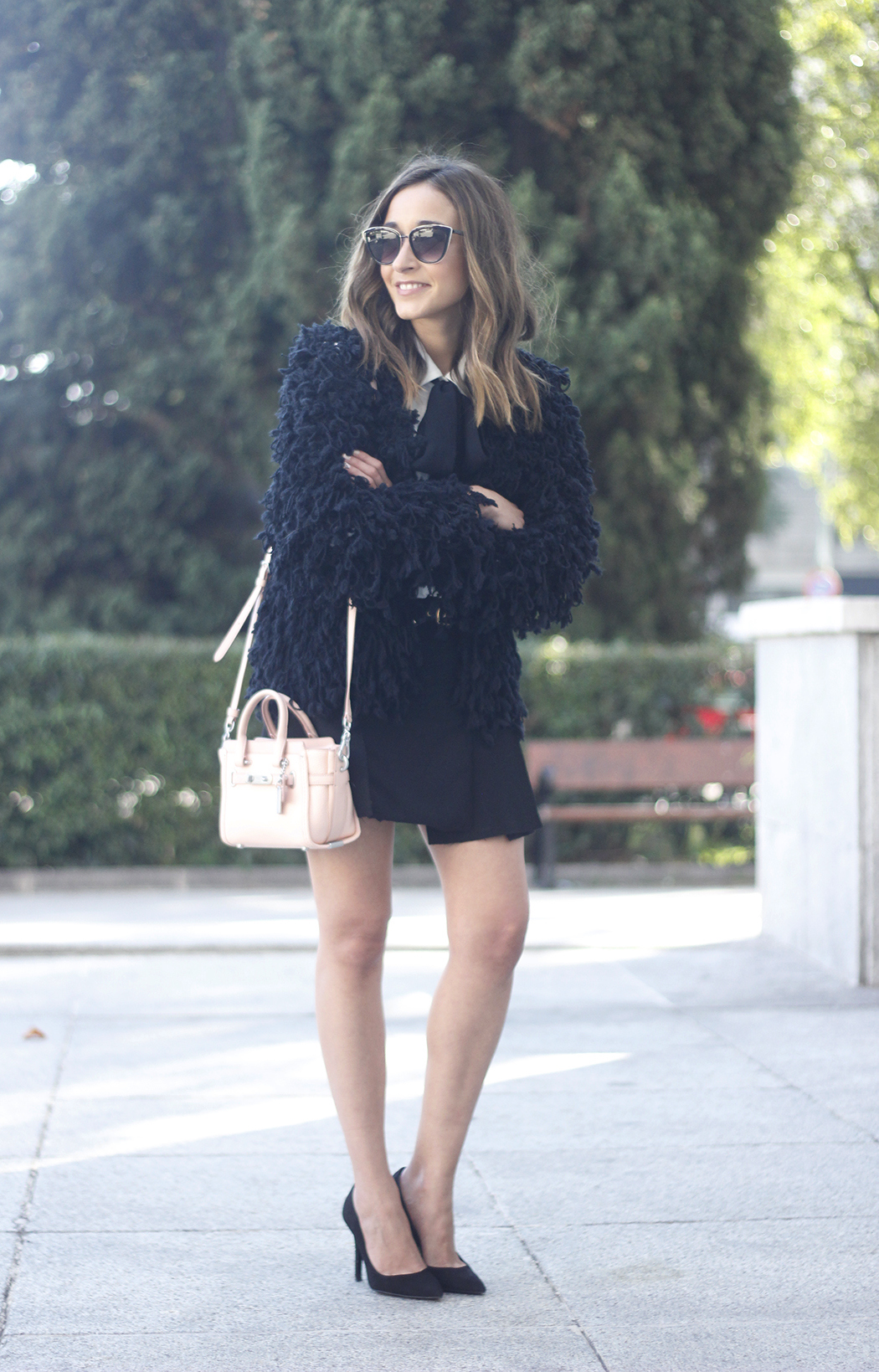 black jacket shirt with black bow coach pink bag heels outfit13