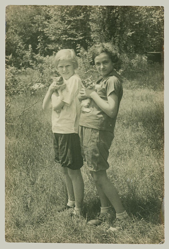 Two children with kittens