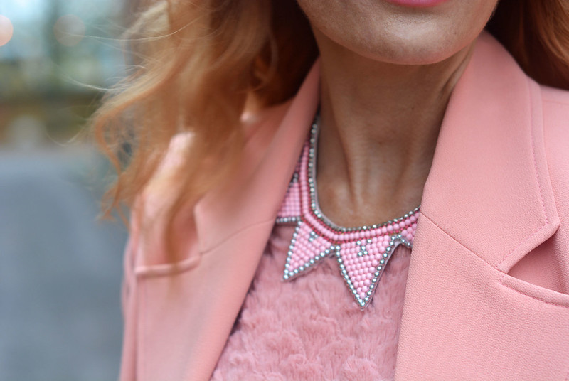 Peach tailored jacket, pink necklace