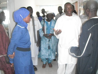 Minister in discussion Midwife listens