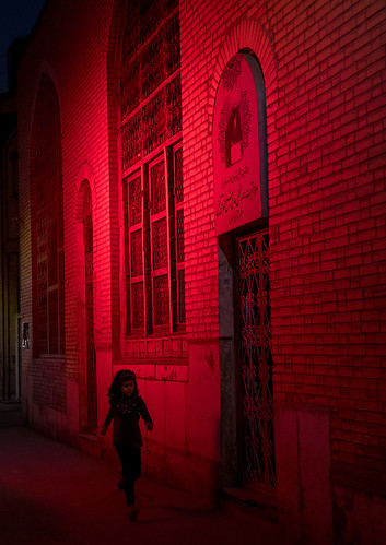 1people architecture ashura buildingexterior child childhood colorimage commemorate commemoration esfahan hispahan hussain illuminated imamhussein iran isfahan islam ispahan light memorialevent middleeast muharram muslim night onegirlonly outdoors persia red religion religious ritual running sepahan shia shiism shiite street urbanscene vertical isfahanprovince ir