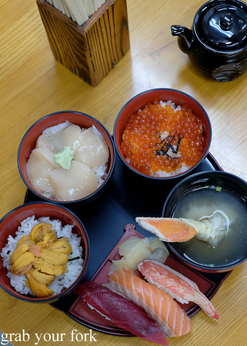 Sushi gozen rice bowl set with sea urchin, scallop, salmon roe, sashimi and crab miso soup at Kondounoboru at Nijo Market, Sapporo