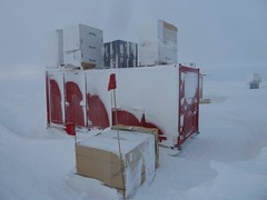Photo of some of the bermed cargo after its first winter-over at the South Pole.