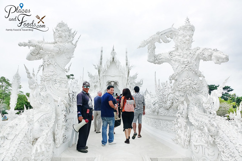 chiang rai white temple warriors arch