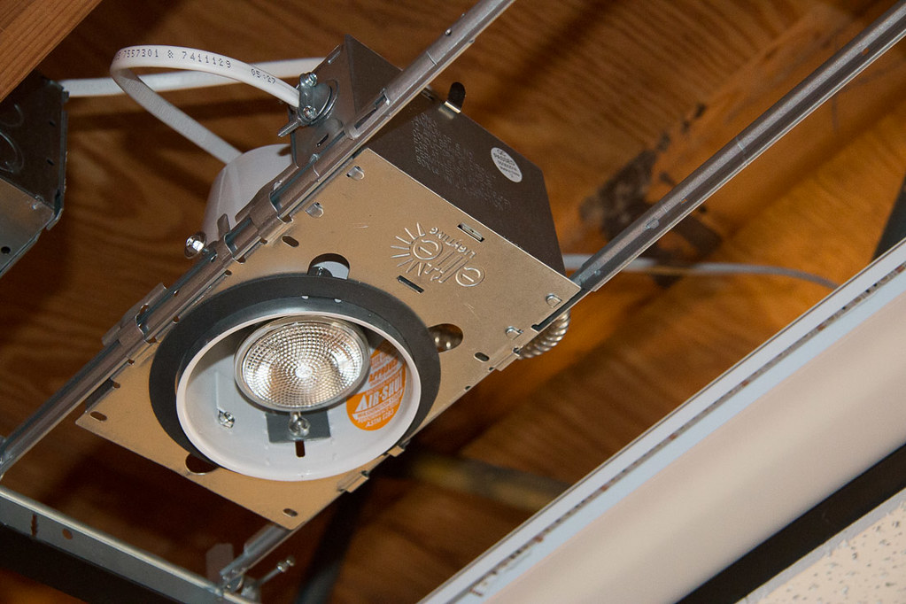 Installing panel enclosure on recessed lighting housing