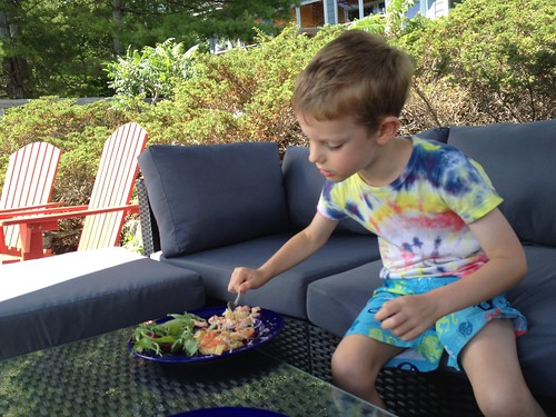 outdoor sectional sofa SANO with boy eating