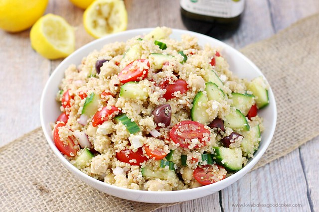 Mediterranean Quinoa Salad in a bowl with lemons.