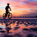 Cycling on Brighton beach at low tide by lomokev
