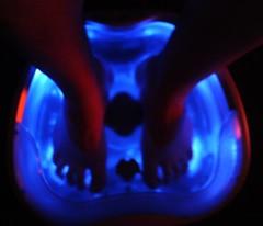 Soaking feet, heated water, massage, glowing blue, red, man feet, Seattle, Washington, USA