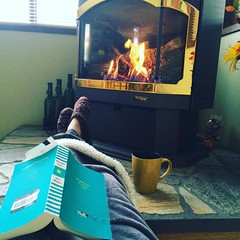 Can't think of a better way to spend my time #cozy #reading #fire #coffee