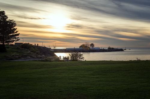 outdoor lake lakeerie ohio cleveland shore sky sunset serene horizon cloud breakwall water evening