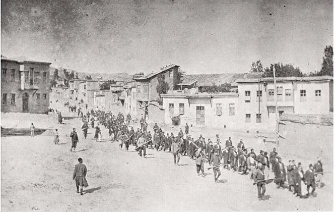 Armenian civilians marched to prison in Mezireh by armed Ottoman soldiers. Kharpert, Ottoman Empire