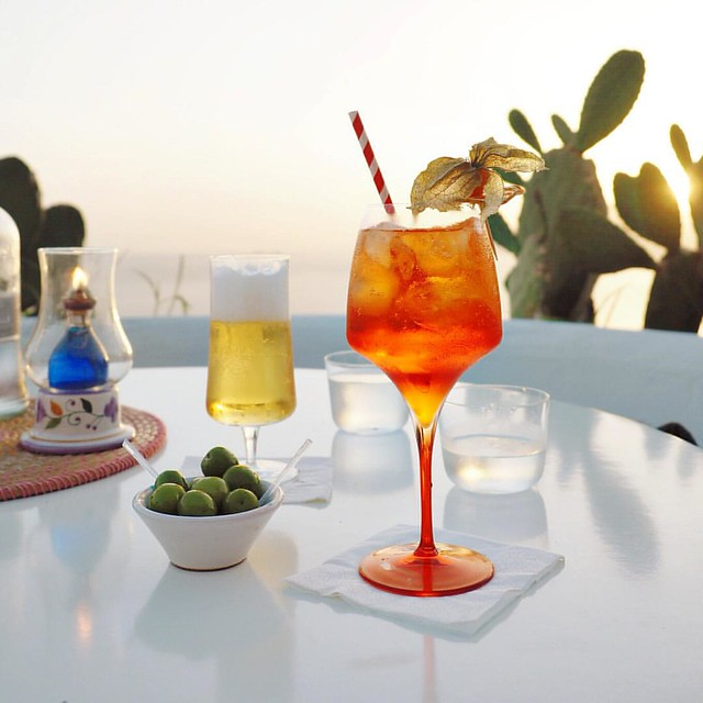 S U N D O W N E R S   Sunset, Aperol Spritz, olives & beer on the roof to see out another day.