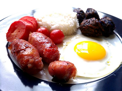longaniza jamonado, tomatoes sunny side-up egg, fried rice blue tater tots